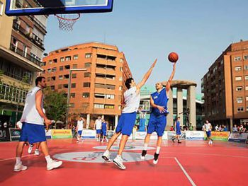 Basketball players in action on the mobile floor